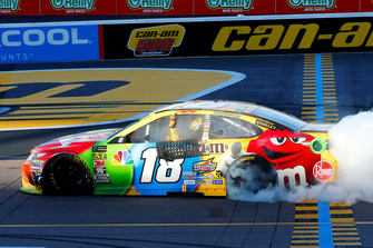 Kyle Busch, Joe Gibbs Racing, Toyota Camry M&M's celebrates his win with a burnout