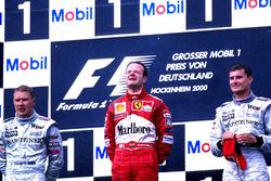 Podium: Race winner Rubens Barrichello, Ferrari F1 2000, second place Mika Hakkinen,  Mclaren  MP4-15