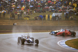 Jacques Villeneuve, Williams FW18 Renault leads Michael Schumacher, Ferrari F310 and Jean Alesi, Benetton B196 Renault