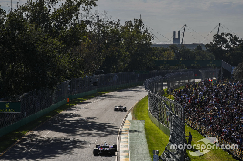 Fernando Alonso, McLaren MCL32, leads Daniil Kvyat, Scuderia Toro Rosso STR12