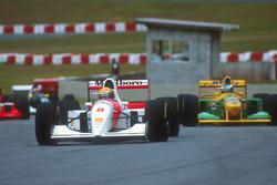 Ayrton Senna, McLaren MP4/8 Ford leads Michael Schumacher, Benetton B192B Ford