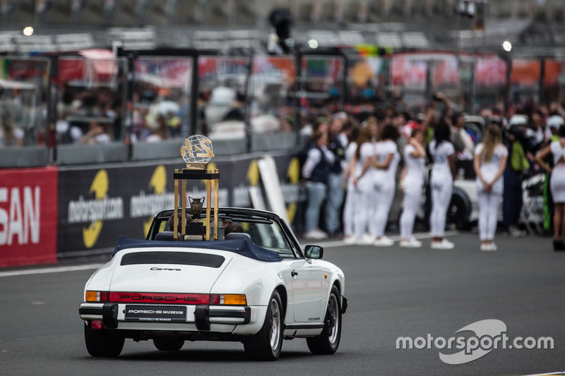The 24 Hours of Le Mans trophy brought with a Porsche 911