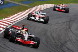 Lewis Hamilton, McLaren MP4-23, leads Jarno Trulli, Toyota TF108 and Heikki Kovalainen, McLaren MP4-23