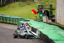 Lewis Hamilton, Mercedes AMG F1 W08, climbs out of his damaged car after crashing out of Q1
