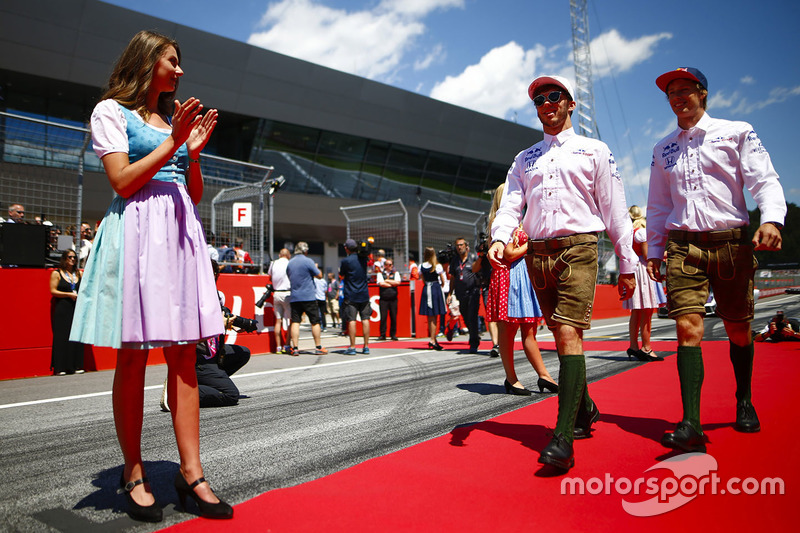 Pierre Gasly, Toro Rosso, and Brendon Hartley, Toro Rosso, in traditional Austrian costume