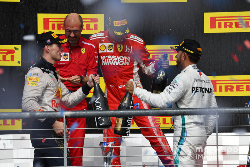 (L to R): Max Verstappen, Red Bull Racing, Carlo Santi, Ferrari Race Engineer, Race Winner Kimi Raikkonen, Ferrari and Lewis Hamilton, Mercedes AMG F1 celebrate on the podium with the champagne