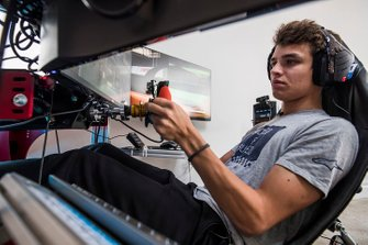 Lando Norris drives a lap of the Interlagos circuit on his home simulator