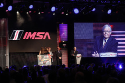 IMSA CEO Scott Atherton presents a Bill Patterson painting to John Stevenson acknowledging his many years of IMSA competition