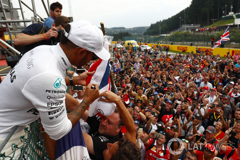 Race winner Lewis Hamilton, Mercedes AMG F1, celebrates with fans after the race