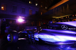 A Mercedes F1 car next to the entrance