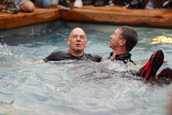 Adrian Newey, Chief Technical Officer, Red Bull Racing, and Christian Horner, Team Principal, Red Bull Racing, celebrate the Daniel Ricciardo, Red Bull Racing, victory in the swimming pool on the Red Bull Energy Station