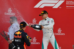 Max Verstappen, Red Bull Racing and Valtteri Bottas, Mercedes-AMG F1 celebrate on the podium with the champagne