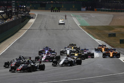 Kevin Magnussen, Haas F1 Team VF-18, leads Romain Grosjean, Haas F1 Team VF-18 and Charles Leclerc, Sauber C37, a the start, as behind Sergio Perez, Force India VJM11, locks-up behind Nico Hulkenberg, Renault Sport F1 Team R.S. 18