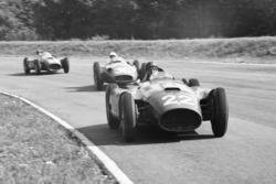 Juan Manuel Fangio, Lancia-Ferrari D50, leads Stirling Moss, Maserati 250F and Peter Collins, Lancia-Ferrari D50