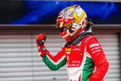 Charles Leclerc celebrates victory