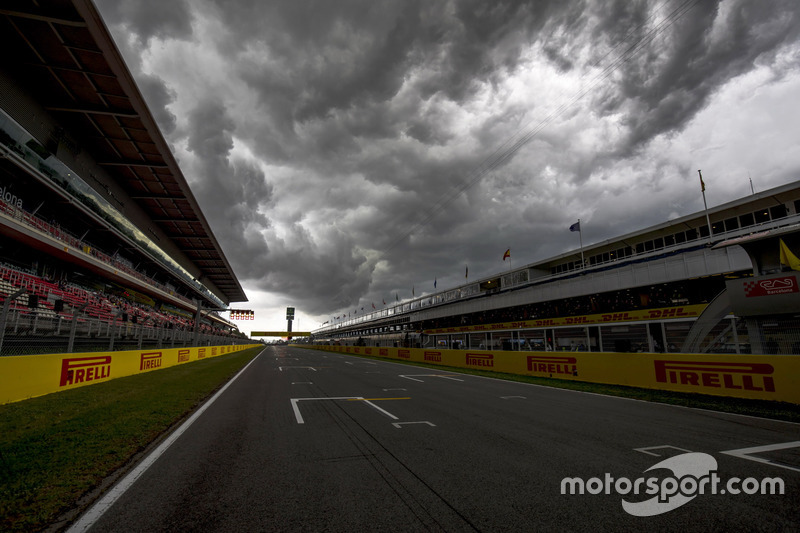 A view of the circuit with stormy skies above