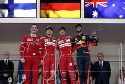 Riccardo Adami, Ferrari Race Engineer, Kimi Raikkonen, Ferrari, race winner Sebastian Vettel, Ferrari and Daniel Ricciardo, Red Bull Racing celebrate on the podium with the trophies