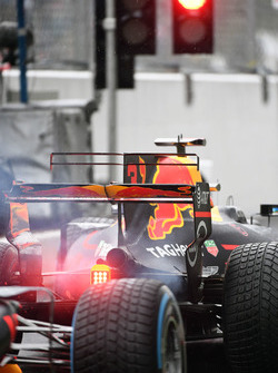 Max Verstappen, Red Bull Racing RB13 and Daniel Ricciardo, Red Bull Racing RB13 wait at the red light at the end of pit lane