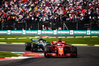 Sebastian Vettel, Ferrari SF71H, leads Lewis Hamilton, Mercedes AMG F1 W09 EQ Power+