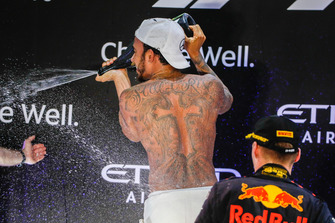 Lewis Hamilton, Mercedes AMG F1, 1st position, strips to the waist and sprays Rose Water on the podium