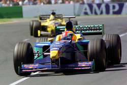 Johnny Herbert, Sauber, leads Damon Hill, Jordan