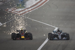 Sparks fly as Max Verstappen, Red Bull Racing RB14 Tag Heuer, battles with Lewis Hamilton, Mercedes AMG F1 W09