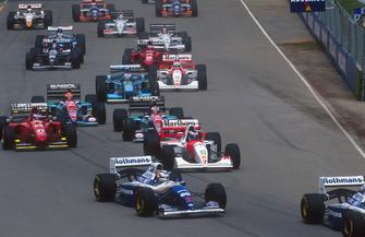 Nigel Mansell follows Damon Hill, Williams FW16B with Mika Hakkinen, McLaren MP4/9, Gerhard Berger, Ferrari 412T1B, Rubens Barrichello, Eddie Irvine, Jordan 194 and Johnny Herbert, Benetton B194, and Martin Brundle, McLaren MP4/9