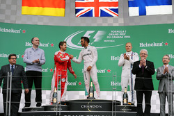 The podium (L to R): Sebastian Vettel, Ferrari, second; Lewis Hamilton, Mercedes AMG F1, race winner