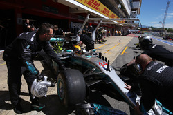 Lewis Hamilton, Mercedes AMG F1 W08, is returned to the garage