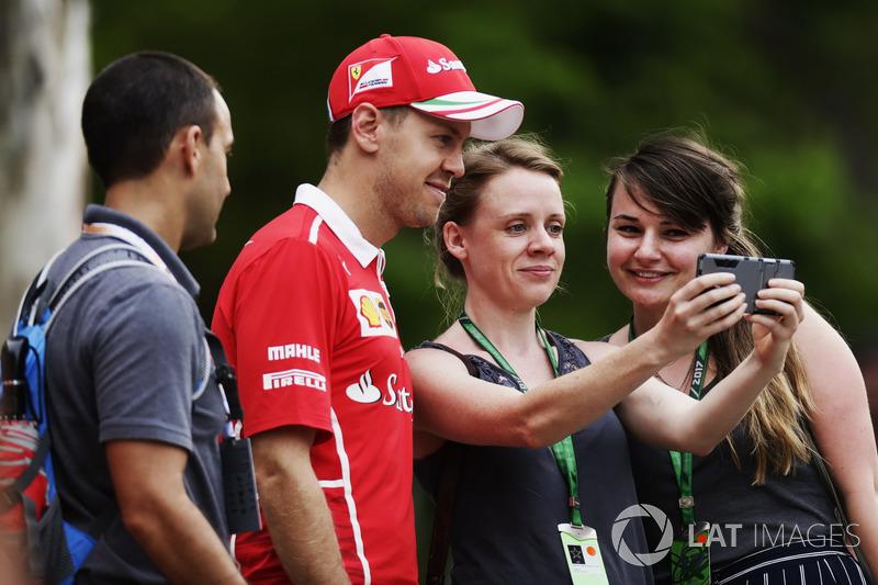 Sebastian Vettel, Ferrari, poses for a photo with a fans