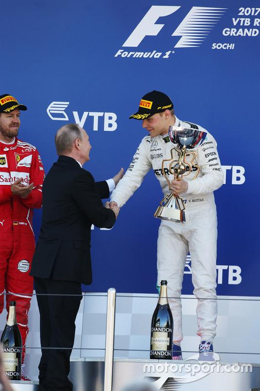 Race winner Valtteri Bottas, Mercedes AMG F1 from Russian President Vladimir Putin, alongside Second place Sebastian Vettel, Ferrari