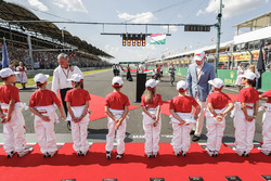 Grid kids shacking hands with Chase Carey, Chairman, Formula One and Sean Bratches, Managing Director of Commercial Operations, Formula One Group