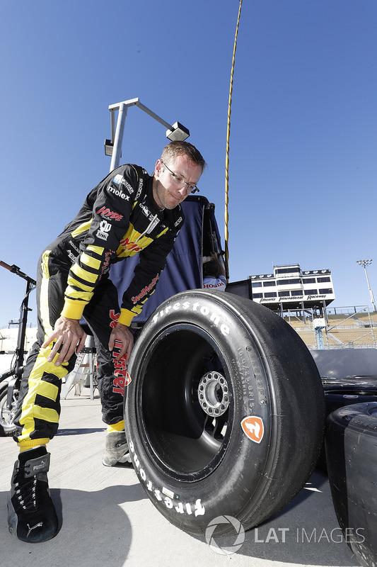 Sébastien Bourdais, Dale Coyne Racing with Vasser-Sullivan Honda examines his Firestone tires