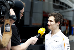 Lando Norris, McLaren, talks to the press