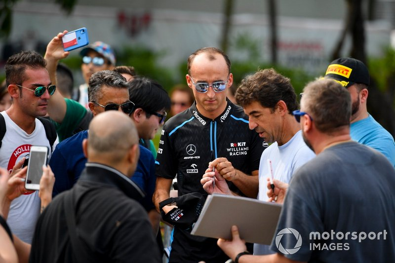 Robert Kubica, Williams Racing signs an autograph for a fan