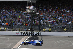 Takuma Sato, Andretti Autosport Honda crosses the finish line and the yard of bricks under the checkered flag for the win