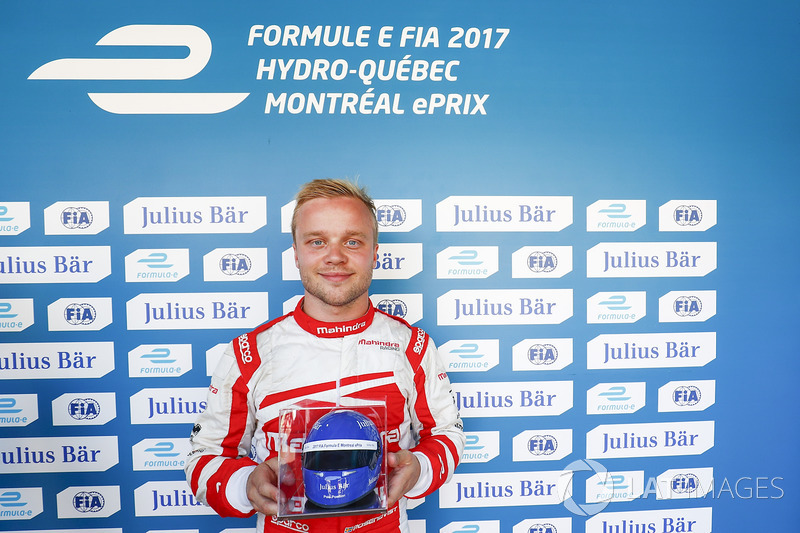 Felix Rosenqvist, Mahindra Racing, celebrates after qualifying with the Julisy Bar award