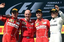 الفائز بالسباق سيباستيان فيتيل، فيراري، المركز الثاني كيمي رايكونن، فيراري، المركز الثالث فالتيري بوتاس، مرسيدس