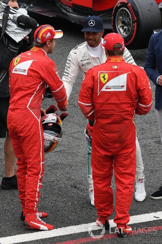 Sebastian Vettel, Ferrari, Lewis Hamilton, Mercedes AMG F1 and Kimi Raikkonen, Ferrari celebrate in
