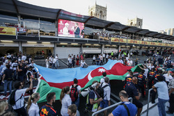 Fans observe podium celebrations, Valtteri Bottas, Mercedes AMG F1 who celebrates on the podium, David Coulthard, the flag of Azerbaijan