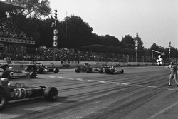Peter Gethin, BRM P160, takes the checkered flag