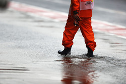 A marshal in the pit lane