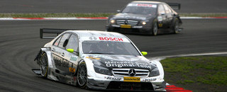 DTM Schneider hangs on to win on soaked Nurburgring