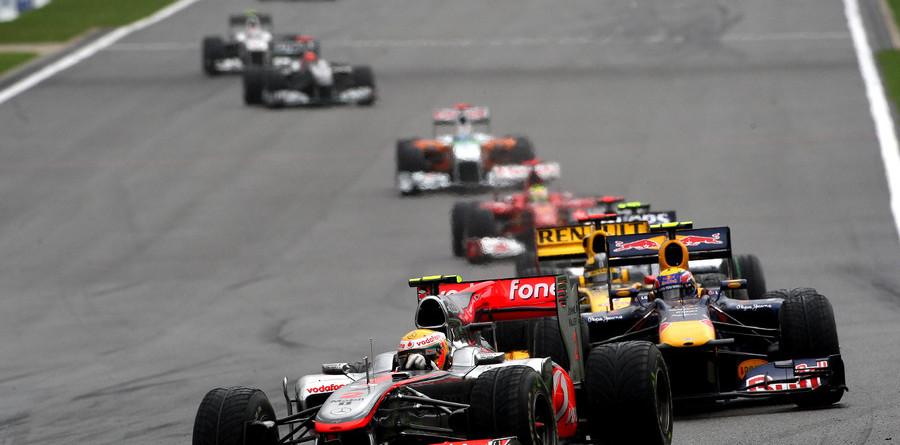 Hamilton cruises to victory at slippery Spa