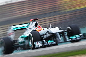 Formula 1 Schumacher tops Friday practice in damp, cold Shanghai