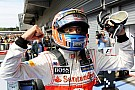 Button dominates amid Spa carnage
