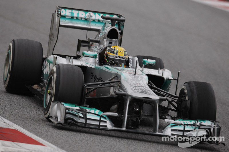 Mercedes' Hamilton takes fastest lap on day four testing in wet Barcelona