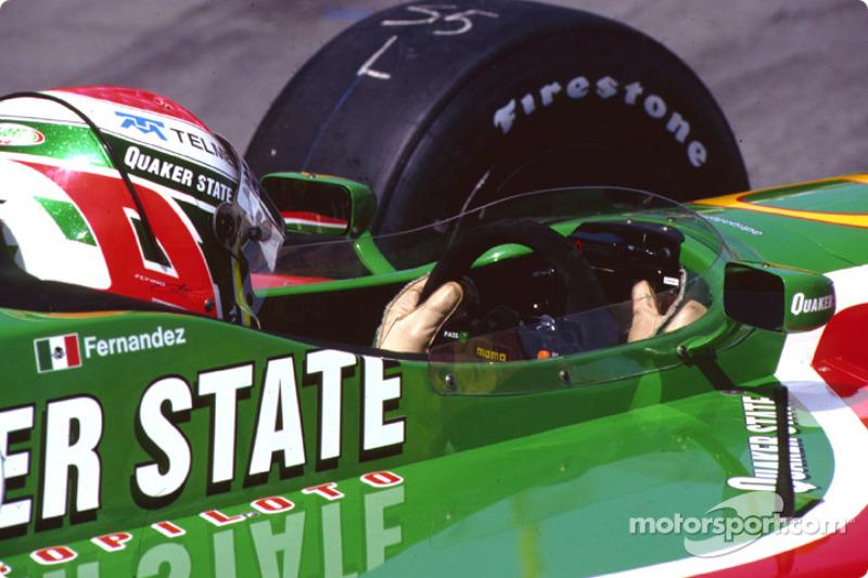 Adrian Fernandez checks the dash