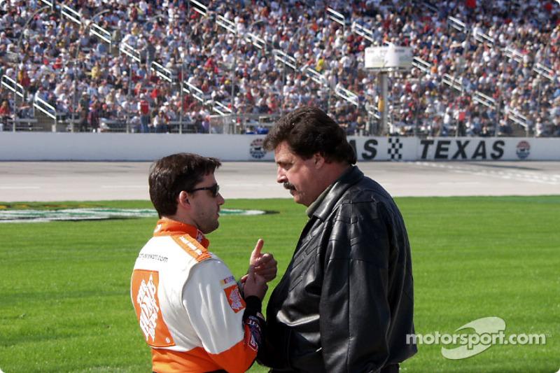 Mike Helton and Tony Stewart talking of something!?