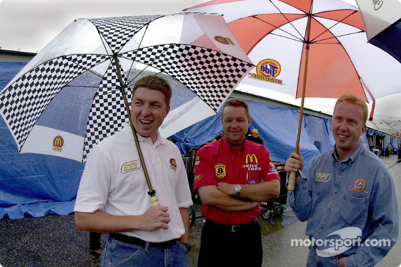 PPI team mates Andy Houston and Ricky Craven wait in the rain to see if qualifying will take place